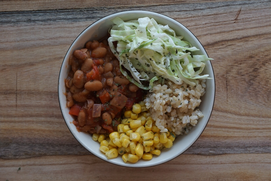 vegan chili bowl with rice corn and coleslaw