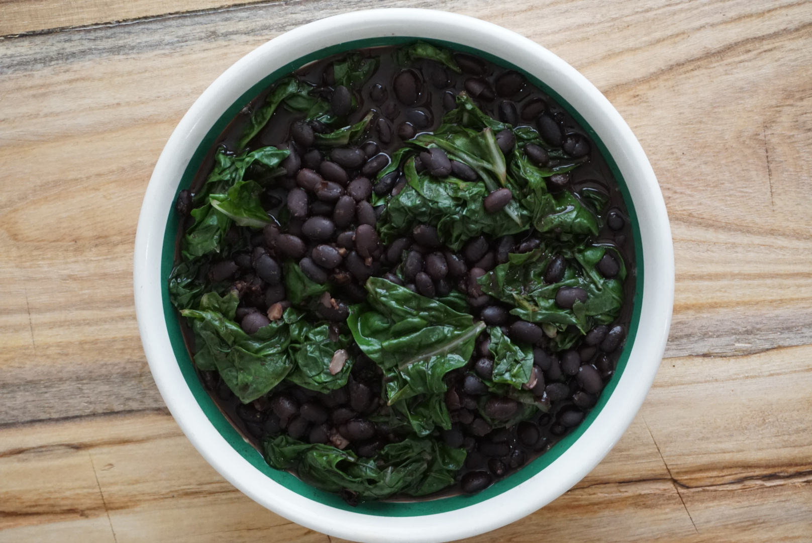 spicy black beans and collard greens plant based dinner