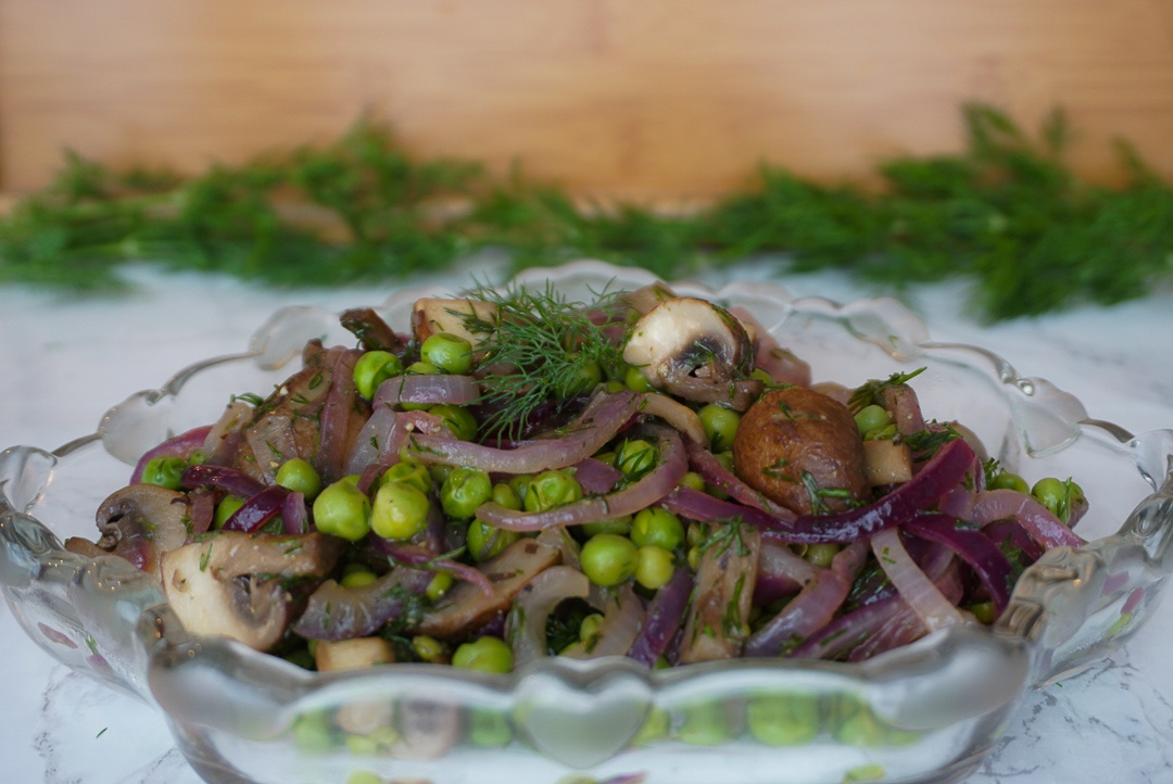 plant based spring pea salad with mushrooms and onions and dill